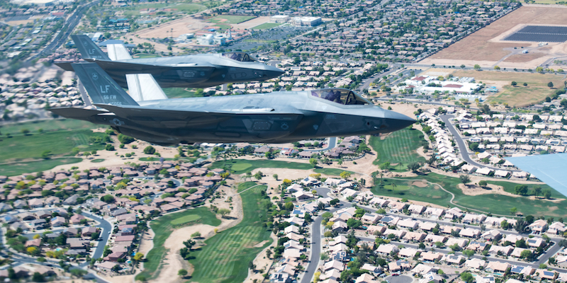 F-35A Lightning IIs piloted by Brig. Gen. Todd Canterbury, 56th Fighter Wing commander, and Col. Jim Greenwald, 944th FW commander, both assigned to Luke Air Force Base, fly in formation during the Air Force Salutes flyover May 1, 2020, over Arizona.The F-35s participated in a 15-aircraft formation including F-35s and F-16 Fightning Falcons from the 56th FW and 944th FWs, and a KC-135 from the 161st Air Refueling Wing as a Total Force salute to each American serving on the frontlines in the fight against Coronavirus Disease 2019. Air Force Salutes flyovers are a way for the U.S. Air Force to show appreciation to the thousands of heroes at the front line battling COVID-19. (U.S Air Force photo by Senior Airman Jacob Wongwai)